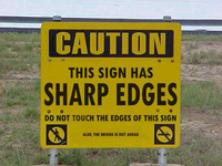 Caution: This Sign Has SHARP EDGES! Do Not Touch The Edges Of This Sign! Also, the bridge is out ahead