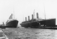 March 6, 1912 - Titanic (right) had to be moved out of the dry dock for her sister Olympic which she lost a propeller